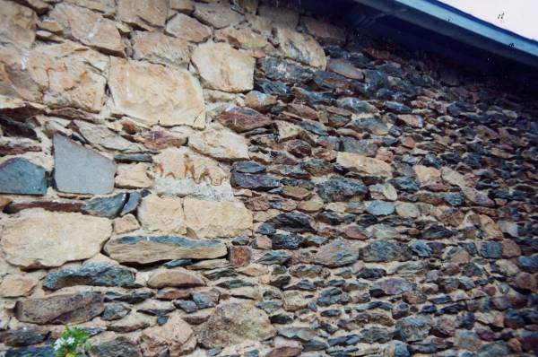 Mortar In Field : Close up of wall made from field stone and rhyolite tuff