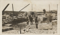 Men cutting blocks of stone in Quarry (location unknown; postcard photograph)
