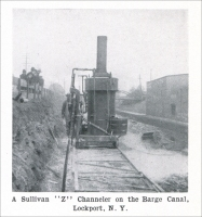 """A Sullivan 'Z' Channeler on the Barge Canal, Lockport, New York. (from Mine and Quarry, Sullivan Machine Company, Chicago, Illinois, Vol. VI, No. 3, March 1912, pp. 583)"