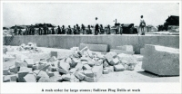 """A rush order for large stones; Sullivan Plug Drills at work."" (From ""Cleaving Granite by Compressed Air,"" in ""Mine and Quarry,"" Sullivan Machinery Co., July-Aug. 1913, pp. 744-749.)"