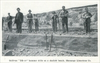 """Sullivan DB-19 hammer drills on a shallow bench, Shenango Limestone Co."" (from ""Quarrying with Hammer Drills"" (in Pennsylvania, Ohio, and Texas), ""Mine and Quarry,"" Aug, 1911, pp. 537)"