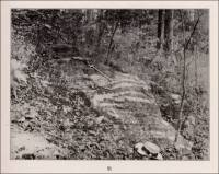 An exposure of a portion of the 25-foot layer of variegated marble w2hich outcrops about 4 miles southeast of Calera, Shelby County, and which belongs to the Montevallo shale and sandstone formation. (circa 1916)