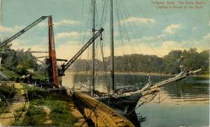 Portland, Connecticut -; The Stone Quarry, Loading a Vessel at the Dock (on a small sailing boat)