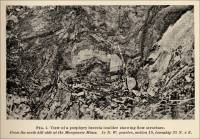Plate I. View of porphyry bluff and needle showing vertical fissures and absence of bedding seams.